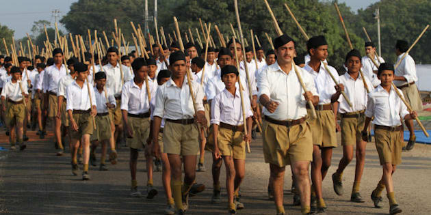 Volunteers of the militant Hindu group Rashtriya Swayamsevak Sangh (RSS) march through a street during a three-day workers camp on the outskirts of Ahmadabad, India, Saturday, Jan. 3, 2015. The RSS, parent organization of the ruling Bharatiya Janata Party, combines religious education with self-defense exercises. The organization has long been accused of stoking religious hatred against Muslims. (AP Photo/Ajit Solanki)
