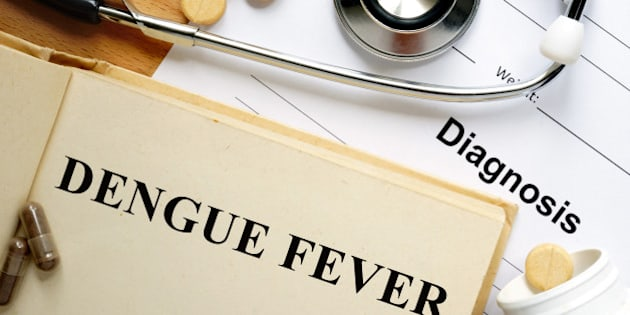 Word Dengue fever  on a book and pills.