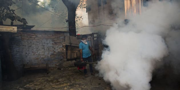 A municipal worker fumigates a residential area to prevent mosquitoes from breeding in New Delhi, India, Wednesday, Sept. 16, 2015. New Delhi has been hit by an outbreak of the mosquito-borne disease, dengue fever. Nearly 1,900 cases have been recorded in the city's hospitals.(AP Photo/Bernat Armangue)
