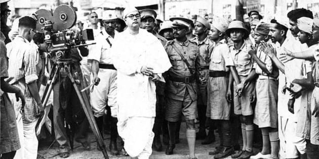This picture shows Mr. Subhash Bose, an unknown name to outsiders, but a mercurial Freedom Fighter and Politician of India of the past, arriving at the 1939 meeting of All india Congress Committee, as its elected President, only to make a tumultuous announcement, that he was quitting the party, and froming his own. This was to protest non-cooperation from Mahatma Gandhi, who wanted to resist Bose's more vigorous and youthful methods of coaxing the British to leave India on the onset of the second world war, as against Gandhi's less vigorous and more gentle approach of passive resistance.