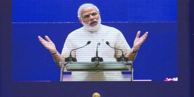 """Indian Prime Minister Narendra Modi speaks at a national meet on """"Promoting Space Technology based Tools and Applications in Governance and Development"""" in New Delhi, India, Monday, Sept. 7, 2015. (AP Photo/ Manish Swarup)"""
