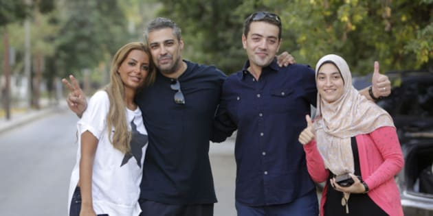 Canadian Al-Jazeera English journalist Mohamed Fahmy second left, and his Egyptian colleague Baher Mohammed, celebrate with their wives after  being released from Torah prison in Cairo, Egypt, Wednesday, Sept. 23, 2015. Fahmy and his colleague Baher, were among a group of 100 people pardoned by Egyptian President Abdel-Fattah el-Sissi on the eve of the major Muslim holiday of Eid al-Adha. The pardon also comes a day before the Egyptian leader is to travel to New York to attend the United Nations General Assembly. (AP Photo/Amr Nabil)