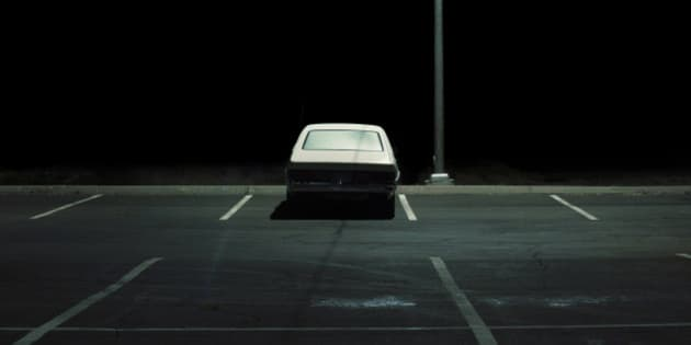 Vehicle in parking lot at night