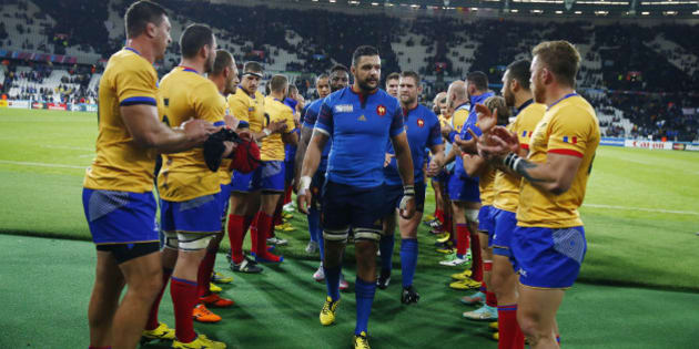 LONDON, ENGLAND - SEPTEMBER 23:  Damien Chouly of France leads the team through a Romanian guard of honour during the 2015 Rugby World Cup Pool D match between France and Romania at the Olympic Stadium on September 23, 2015 in London, United Kingdom.  (Photo by Chris Lee - World Rugby/World Rugby via Getty Images)
