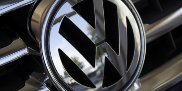 Close up of Volkswagen logo on car grill