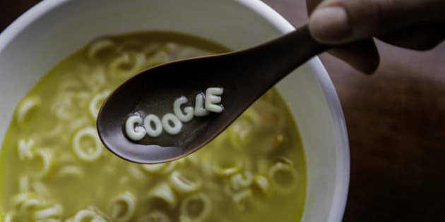 Campbell Soup Co. letters spell out the word 'Google' on a spoon in this arranged photograph taken in New York U.S., on Wednesday, Aug. 12, 2015. Google Inc. rose as much as 6.5 percent after reorganizing into a holding company called Alphabet Inc., breaking out its main Web operations from ambitious new endeavors such as research lab Google X and Calico, which seeks to extend human lives. The structure, announced Monday, will give greater clarity into how Google invests in various ventures, including driverless cars, high-speed Internet service and health-related technologies. Photographer: Chris Goodney/Bloomberg via Getty Images