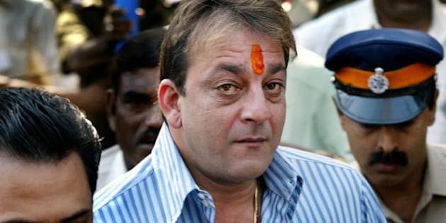Bollywood actor Sanjay Dutt arrives to surrender before the Terrorist and Disruptive Activities (TADA) court in Mumbai, India, Tuesday, Dec. 19,  2006. Dutt, whose bail ends on Tuesday, was convicted under the Arms Act in India's lengthiest court trial over the March 12, 1993 bomb blasts that killed 257 people. (AP Photo/Gautam Singh)