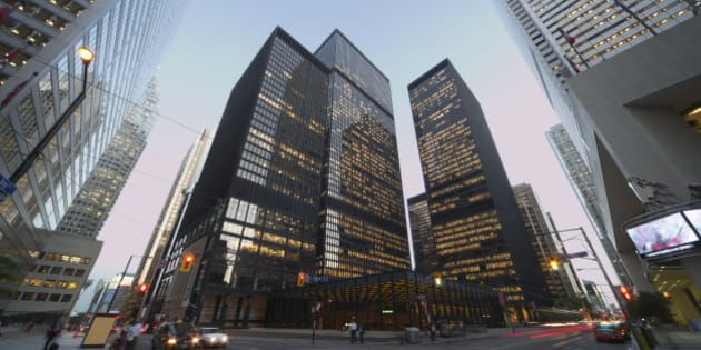 Corner of Bay Street and King Street at dusk in the Financial District of Toronto at dusk.
