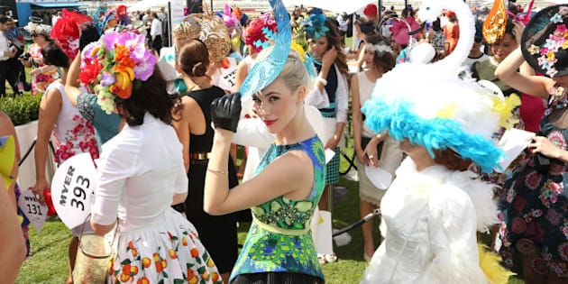 MELBOURNE, AUSTRALIA - NOVEMBER 04:  Myer Fashions on the Field entrants line up in the Fashion on the Field enclosure on Melbourne Cup Day at Flemington Racecourse on November 4, 2014 in Melbourne, Australia.  (Photo by Graham Denholm/Getty Images for the VRC)