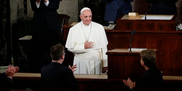 Vice President Joe Biden and House Speaker John Boehner of Ohio and others applaud Pope Francis as he arrives to address a joint meeting of Congress on Capitol Hill in Washington, Thursday, Sept. 24, 2015, making history as the first pontiff to do so. (AP Photo/Carolyn Kaster)
