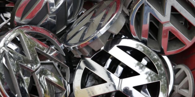 Volkswagen ornaments sit in a box in a scrap yard in Berlin, Germany, Wednesday, Sept. 23, 2015. The revelation that Volkswagen rigged diesel-powered cars to emit lower emissions during EPA tests is particularly stunning since Volkswagen has long projected a quirky brand image with an emphasis on being environmentally friendly _ an image that now appears in tatters. (AP Photo/Michael Sohn)