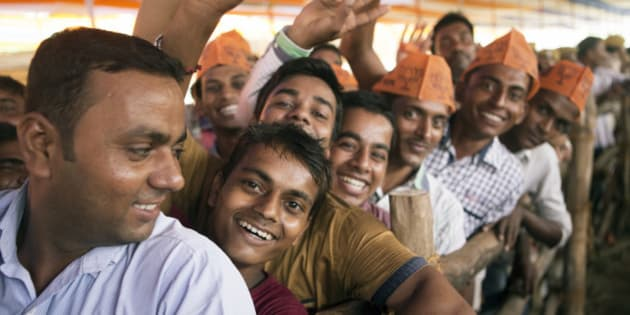 Supporters of the Bharatiya Janata Party (BJP) stand in line to hear Indian Prime Minister Narendra Modi speak at a rally in Muzaffarpur, Bihar, India, on Saturday, July 25, 2015. More than anywhere, Bihar reflects the challenge Prime Minister Narendra Modi faces in overhauling modern India. A vast, landlocked plain bordering the Himalayan nation of Nepal to the north and bisected by the Ganges, India's holiest river, the state is home to about one in 12 Indians. Photographer: Prashanth Vishwanathan/Bloomberg via Getty Images