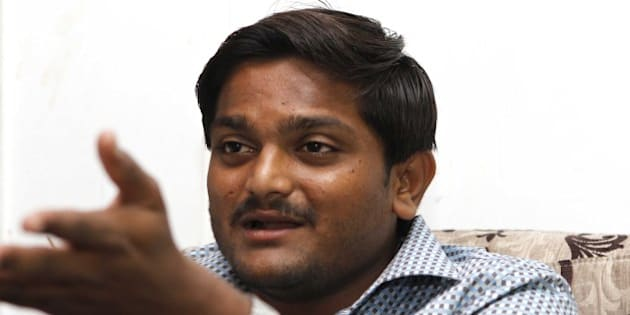 NEW DELHI, INDIA - AUGUST 30: Hardik Patel, Convener of Patidar Anamat Andolan Samiti (PAAS), during an interview with Hindustan Times, at GK-II on August 30, 2015 in New Delhi, India. Patel announced in today's press conference that he won't allow any political party to join his agitation and he wants to turn the stir into a national movement. He strongly defended his demand for reservation for Patels or Patidars, saying they are not getting jobs due to reservation. He said, 'We are not here to meet any ministers. Political parties are not welcome in the agitation.' (Photo by Virendra Singh Gosain/Hindustan Times via Getty Images)