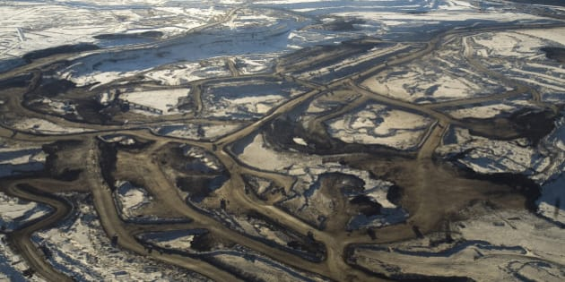 FORT MCMURRAY, ALBERTA, CANADA - NOVEMBER 2008: Aerial views of the mines of Syncrude Canada Ltd and Suncor Energy Inc. Tar sands, or oil sands, are very dense and contain a form of petroleum The world's largest reserves of tar sands in Canada and Venezuela. Tar sands could equate to approximately two thirds of the total global petroleum resource. Until recently it was financially not viable to extract the oil from the sands, but new technology and rising oil prices have now made it viable. (Photo by Veronqiue de Viguerie/Getty Images)