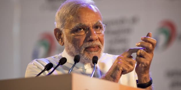 Indian Prime Minister Narendra Modi, makes a gesture of dialing phone as he addresses people during the launch of digital India project in New Delhi, India, Wednesday, July 1, 2015. The initiative involves creating opportunities for all Indian citizens by harnessing digital technologies, to empower every citizen with access to digital services, knowledge and information. (AP Photo/Saurabh Das)