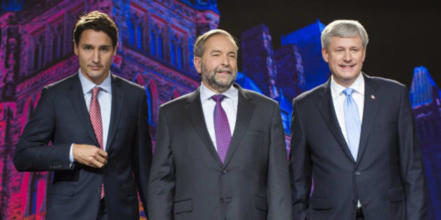 Justin Trudeau, leader of the Liberal Party of Canada, from left, Thomas 'Tom' Mulcair, leader of the New Democratic Party, and Conservative Leader Stephen Harper, Canada's prime minister, stand for a photograph prior to the second leaders' debate in Calgary, Alberta, Canada, on Thursday, Sept. 17, 2015. The debate pits Harper and his Conservative Party's program of tax cuts and spending restraint against the Liberal Party's Trudeau who is pledging to raise taxes on the highest earners and Mulcair of the New Democratic Party who advocates increasing levies on corporations. Photographer: Ben Nelms/Bloomberg via Getty Images