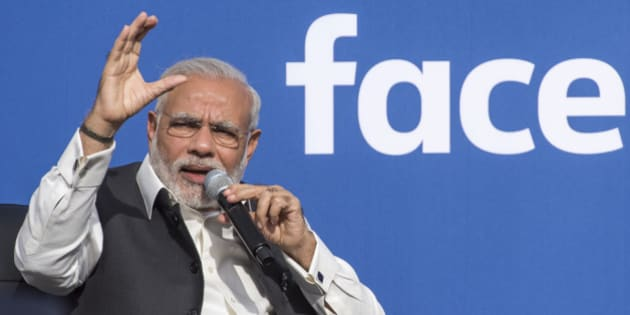 Narendra Modi, India's prime minister, left, speaks at Facebook Inc. headquarters in Menlo Park, California, U.S., on Sunday, Sept. 27, 2015. Prime Minister Modi plans on connecting 600,000 villages across India using fiber optic cable as part of his 'dream' to expand the world's largest democracy's economy to $20 trillion. Photographer: David Paul Morris/Bloomberg via Getty Images