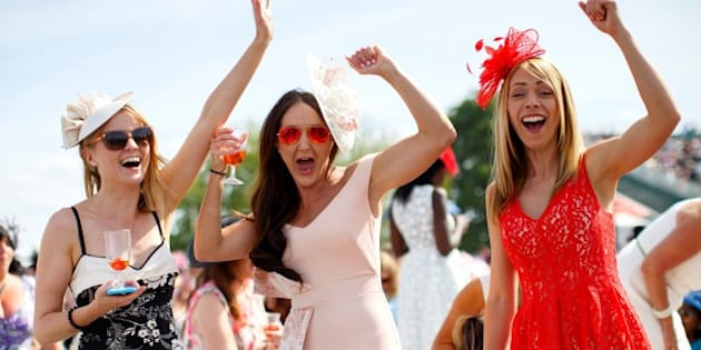 ASCOT, UK. 18 JUNE: Racegoers celebrating after winning a bet on a race on Ladies Day of Royal Ascot at Ascot racecourse in Berkshire, England on June 18, 2015. The 5 day showcase event, which is one of the highlights of the racing calendar, has been held at the famous Berkshire course since 1711 and tradition is a hallmark of the meeting. Top hats and tails remain compulsory in parts of the course. (Photo by Tolga Akmen/Anadolu Agency/Getty Images)