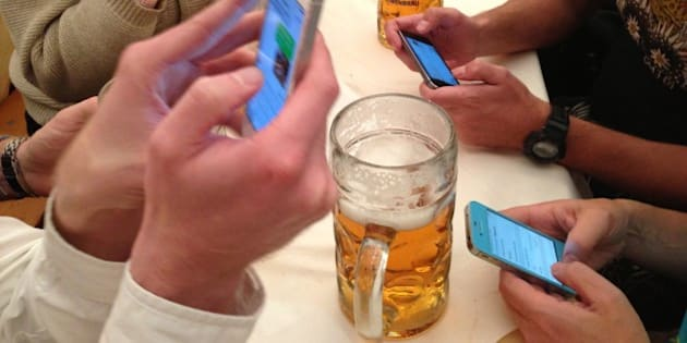 Oktoberfest Bavaria Germany Smartphone Communication and Stein of Beer as a Group of People