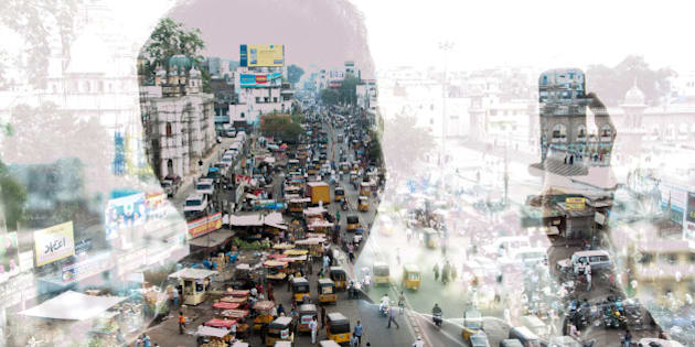 double exposure of a man taking a photo with a smart phone in India and cityscape
