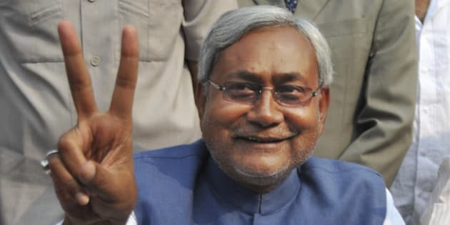 Bihar state Chief Minister Nitish Kumar displays the victory sign during a press conference after his National Democratic Alliance won the state elections, in Patna, India, Wednesday, Nov. 24, 2010. Kumar, the top elected official of one of India's poorest states, has won a landslide re-election victory after a campaign that emphasized his efforts to bring development to Bihar and broke away from traditional caste-based politics. (AP Photo/Aftab Alam Siddiqui)