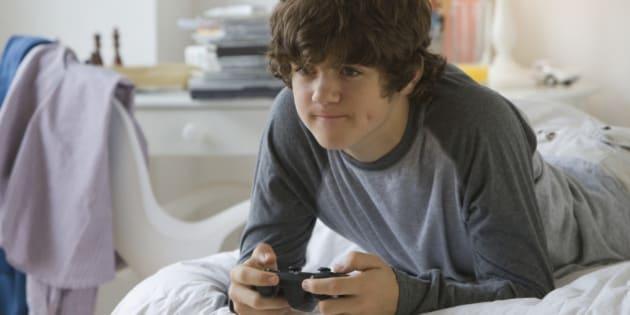 Teenaged boy playing video games