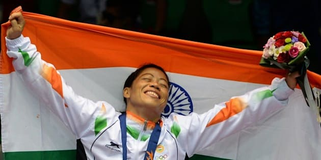 Gold medallist India's Hmangte Chungneijang Mary Kom celebrates during the victory ceremony after winning the women's flyweight (48-51kg) boxing final match against Kazakhstan's Shekerbekova Zhaina during the 2014 Asian Games at the Seonhak Gymnasium in Incheon on October 1, 2014. AFP PHOTO/ INDRANIL MUKHERJEE        (Photo credit should read INDRANIL MUKHERJEE/AFP/Getty Images)