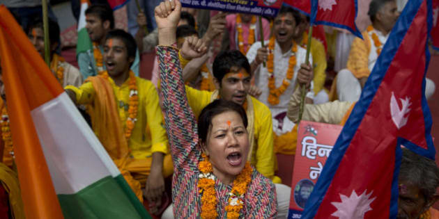 A Nepali woman shouts slogans during a protest against the Nepalese government and demanding it be restored as a Hindu nation, in New Delhi, India, Tuesday, Sept. 22, 2015. Nepal says protests against its new constitution formally adopted on Sept. 20, 2015, are abating, just hours after police opened fire on a crowd and injured three in the east of the Himalayan nation. (AP Photo/Tsering Topgyal)