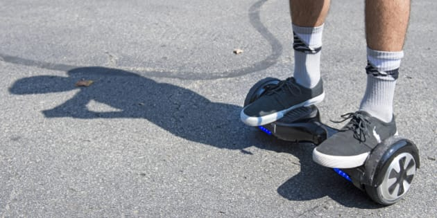 Logan Meis, 20, balances on his hover board outside his apartment complex in Overland Park, Kan., on Friday, Sept. 4, 2015. Meis purchased the personal transportation device for about $330 online. (Tammy Ljungblad/Kansas City Star/TNS via Getty Images)