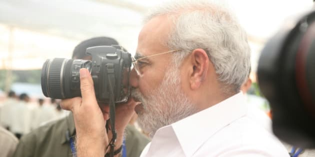 INDIA - NOVEMBER 12:  Narendra Modi, Chief Minister of Gujarat with Camera in Gujarat, India ( Photographer )  (Photo by Shailesh Raval/The India Today Group/Getty Images)