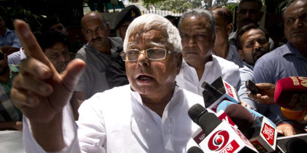 Rashtriya Janata Dal (RJD) leader Lalu Prasad Yadav speaks to reporters after a meeting with Samajwadi Party (SP) leader Mulayam Singh Yadav in New Delhi, India, Friday, May 22, 2015. The leaders reportedly met to sort out seat sharing issues ahead of the Bihar state elections, expected later this year. (AP Photo/Saurabh Das)