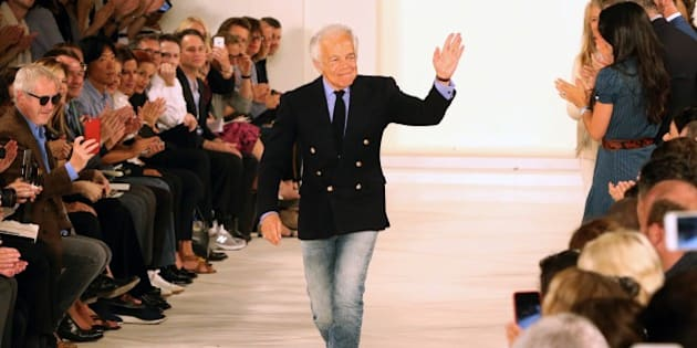 Designer Ralph Lauren is applauded by the audience after his presentation at New York Fashion Week in New York on September 17, 2015. AFP PHOTO/TREVOR COLLENS        (Photo credit should read TREVOR COLLENS/AFP/Getty Images)