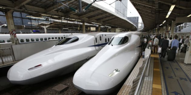 In this Sept. 24, 2014 photo, passengers get into the Shinkansen bullet train at Tokyo station in Tokyo. Japan launched its bullet train between Tokyo and Osaka 50 years ago Wednesday, Oct. 1, 2014. (AP Photo/Shizuo Kambayashi)