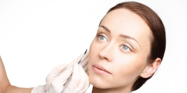 Plastic surgery, a woman in the clinic of aesthetic surgery