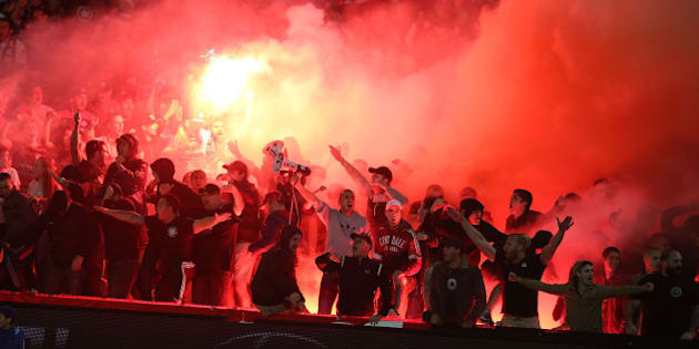 GOSFORD, AUSTRALIA - APRIL 11:  Western Sydney wanderers fans let off flares during the round 25 A-League match between the Central Coast Mariners and the Western Sydney Wanderers at Central Coast Stadium on April 11, 2015 in Gosford, Australia.  (Photo by Tony Feder/Getty Images)