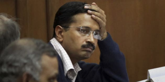 Anti-graft activist Arvind Kejriwal attends a session on Jan Lokpal, a strong legislation to end corruption, in the Delhi Assembly in New Delhi, India, Friday, Feb. 14, 2014. Kejriwal says he has resigned as the top elected official in the New Delhi state government after lawmakers blocked the introduction of a bill to create a strong ombudsman in the Indian capital.  (AP Photo)