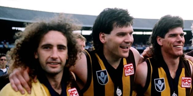 1986: John Platten, Jason Dunstall, Gary Ayres, Dermott Brereton and John Kennedy of Hawthorn celebrate their win, in the VFL Grand Final match between Hawthorn and Carlton, played at the Melbourne Cricket Ground, Melbourne, Australia.  Mandatory Credit:Tony Feder/ALLSPORT