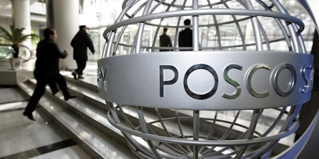 Visitors walk past a sculpture displaying the Posco logo at the company's headquarters in Seoul, South Korea, Thursday, Jan. 11, 2007. Posco, the world's third largest steel maker, said Thursday its fourth-quarter profit soared, helped mainly by higher steel prices and lower raw material costs. (AP Photo/ Lee Jin-man)