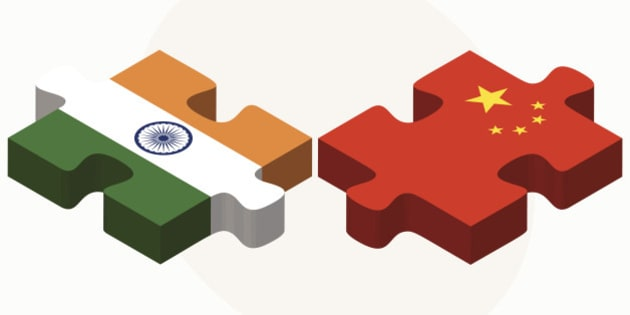 Vector Image - India and China Flags in puzzle isolated on white background