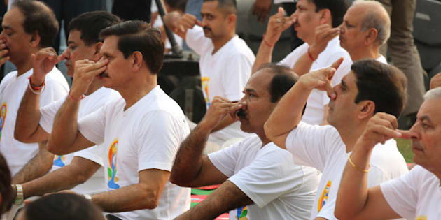 NEW DELHI, INDIA - JUNE 21: Indian Army Chief General Dalbir Singh Suhag, Air Chief Marshal Arup Raha, Navy Chief Admiral RK Dhowan participate in mass yoga session led by Prime Minister Narendra Modi (not seen in the picture) to mark the International Day of Yoga at Rajpath on June 21, 2015 in New Delhi, India. An estimated 40,000 people participated in the celebrations at Rajpath, with around two billion people taking part across the world. The yoga celebrations are being organised after the United Nations had in December last year declared June 21 as International Yoga Day. (Photo by Arvind Yadav/Hindustan Times via Getty Images)