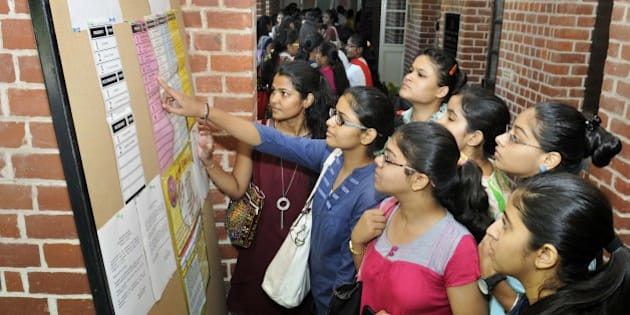 NEW DELHI, INDIA - SEPTEMBER 11: Students queue up to cast their votes for the Delhi Univesity Students Union (DUSU) Elections 2015, at Miranda House, North Campus, on September 11, 2015 in New Delhi, India. A total of 35 candidates are in the fray for the four posts of DUSU office-bearers. While nine candidates are in the race for the post of President, eight nominations have been validated for the post of Vice-President. The number of students contesting for the secretary and joint secretary post is 10 and eight respectively. Students say that they want a rollback of the Choice Based Credit System (CBCS) and proper hostel facilities. (Photo by Sushil Kumar/Hindustan Times via Getty Images)