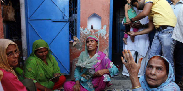 Relatives mourn the killing of 52-year-old Muslim farmer Mohammad Akhlaq at his home in Bisara, a village about 45 kilometers (25 miles) southeast of the Indian capital of New Delhi, Wednesday, Sept. 30, 2015. Indian police arrested eight people and were searching Wednesday for two more after villagers allegedly beat Akhlaq to death and severely injured his son upon hearing rumors that the family was eating beef, a taboo for many among India's majority Hindu population. Since Prime Minister Narendra Modi, a Hindu nationalist, took office last year, hard-line Hindus have been demanding that India ban beef sales, a key industry for many within India's poor, minority Muslim community. In many Indian states, the slaughtering of cows and selling of beef are either restricted or banned. (AP Photo/Manish Swarup)