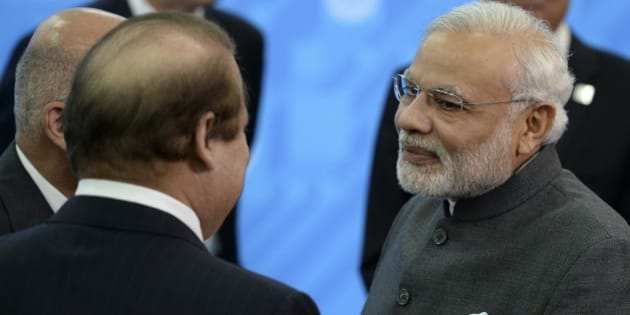 Indian Prime Minister Narendra Modi, right, speaks to Prime Minister of Pakistan Muhammad Nawaz Sharif, back to a camera, during the SCO (Shanghai Cooperation Organization) summit in Ufa, Russia, Friday, July 10, 2015.   (Host photo agency/RIA Novosti Pool Photo via AP)
