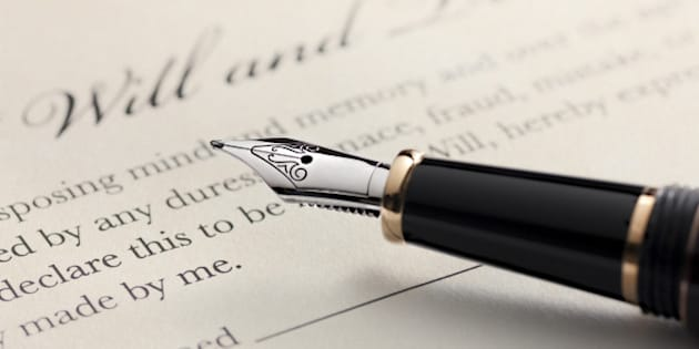 Last will and testament document with closeup on fountain pen with signature line. Critical focus on fountain pen.