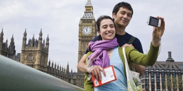 Couple posing for self portrait by Big Ben, London, England