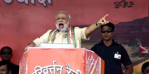 BHAGALPUR, INDIA - SEPTEMBER 1: Prime Minister Narendra Modi addresses a public rally ahead of the upcoming Bihar elections on September 1, 2015 in Bhagalpur, India. Prime Minister Modi delivered his fourth and final Parivartan rally speech before the declaration of dates of Bihar assembly elections. He launched a scathing attack on the Nitish-led Bihar Government and demanded that the united opposition of Janata Pariwar should give an account of its 'work' done in Bihar over the last 25 years. (Photo by Santosh Kumar/Hindustan Times via Getty Images)