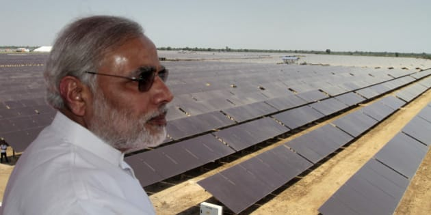 Gujarat state Chief Minister Narendra Modi overlooks the panels at a newly inaugurated solar energy farm at Gunthawada in Gujarat state, about 175 kilometers (109 miles) north of Ahmadabad, India, Friday, Oct. 14, 2011. The 30 mega-watt solar farm built by Moser has been set up with an investment of Rupees 4.65 billion (US $96,875,000) and uses 236,000 thin film modules, according to an official release. (AP Photo/Ajit Solanki)