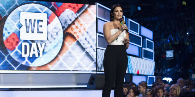 Demi Lovato speaks at We Day on Thursday, Oct. 1, 2015, in Toronto. (Photo by Arthur Mola/InvisionAP)
