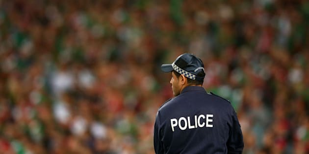 SYDNEY, AUSTRALIA - OCTOBER 05:  A policeman looks on during the 2014 NRL Grand Final match between the South Sydney Rabbitohs and the Canterbury Bulldogs at ANZ Stadium on October 5, 2014 in Sydney, Australia.  (Photo by Mark Kolbe/Getty Images)