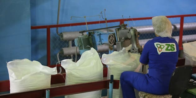 A female worker uses a sewing machine to stitch closed sacks of sugar as they pass along a conveyor belt at the Zainsk sugar plant, operated by ZAO Agrosila Group, in Zainsk, Russia, on Friday, Sept. 4. 2015. Raw-sugar futures turned a bit sweeter for bulls, climbing the most in almost four years on concerns that adverse weather may hurt crops in Brazil and India, the top producing countries. Photographer: Andrey Rudakov/Bloomberg via Getty Images
